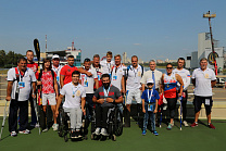 "P.A. Rozhkov on the rowing channel ""Krylatskoe"" in the framework of the Cup of the President of the Russian Federation for canoe and kayak events met with the National Paracanoe Team"